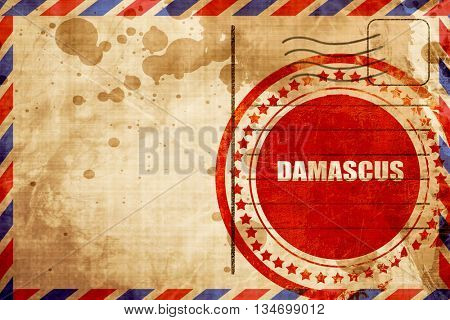 damascus, red grunge stamp on an airmail background