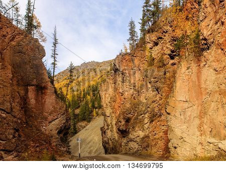 road in the mountains between the rocks in autumn