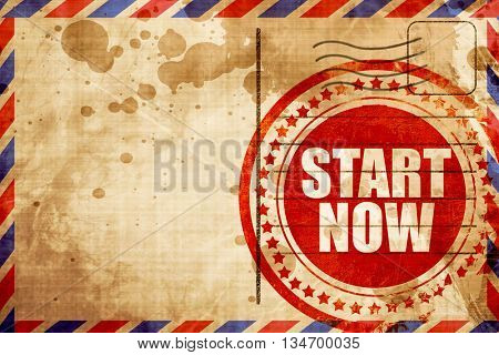 start now, red grunge stamp on an airmail background