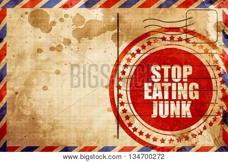 stop eating junk, red grunge stamp on an airmail background