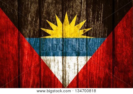 Antigua and Barbuda on old wood background