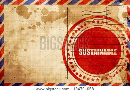 sustainable, red grunge stamp on an airmail background