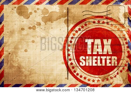 tax shelter, red grunge stamp on an airmail background