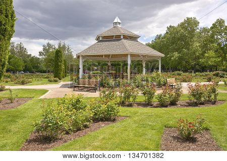 Gazebo a rose garden and stormy clouds in a public park Boise Idaho.