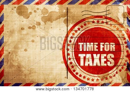 time for taxes, red grunge stamp on an airmail background
