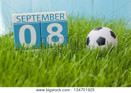 September 8th. Image of september 8 wooden color calendar on green grass lawn background. Autumn day. Empty space for text. International Day Of Journalists' Solidarity.