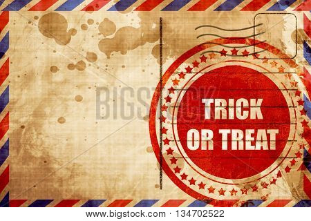 trick or treat, red grunge stamp on an airmail background