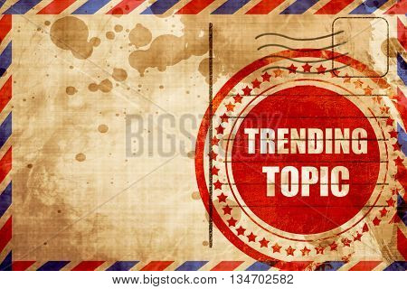 trending topic, red grunge stamp on an airmail background
