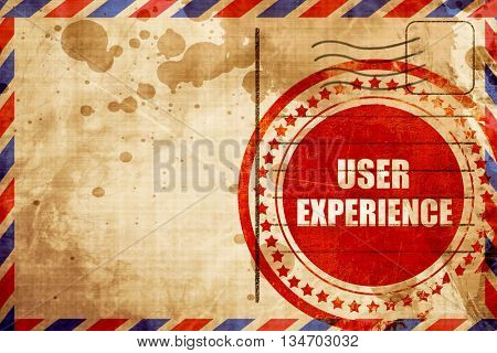 user experience, red grunge stamp on an airmail background