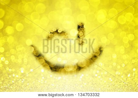 Abstract yellow emoji smiley face wink emoticon bokeh background