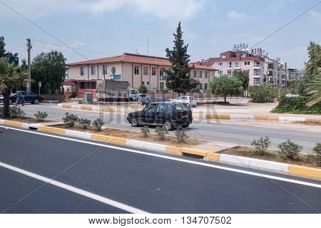 ANTALYA TURKEY - JULY 10 2015: On the streets of Antalya. Local flavor and good roads attract tourists