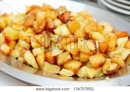 French farm frites potato wedges in stainless steel bowl