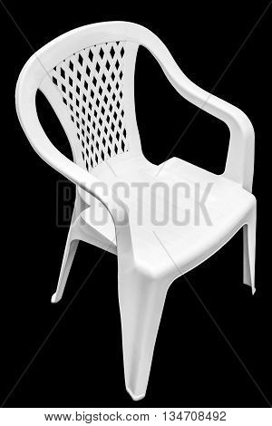 White plastic chair close-up on a black background