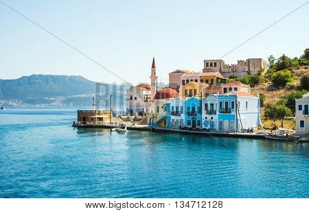 View over the houses and mosque on Greek islands Kastelorizo and the sea from the bay