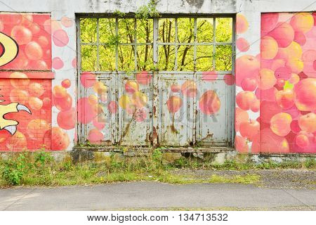 Saint Clair sur Epte France - october 10 2015 : paint on the wall of a ruin factory