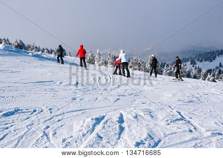 Kopaonik, Serbia - January 22, 2016: Ski resort Kopaonik, Serbia, people skiing down the hill, mountains view, fog