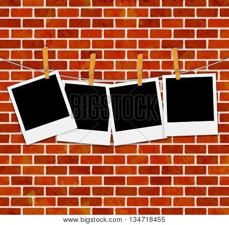 set of photo frames on rope with clothespins on brick wall vector