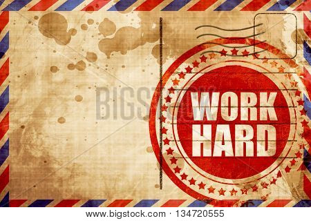 work hard, red grunge stamp on an airmail background