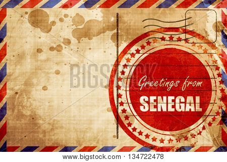 Greetings from senegal, red grunge stamp on an airmail backgroun