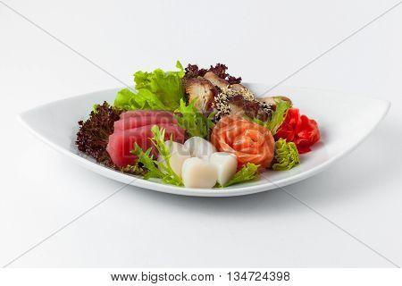 food in a plate: tuna salmon smoked eel scallops sesame wasabi ginger and herbs