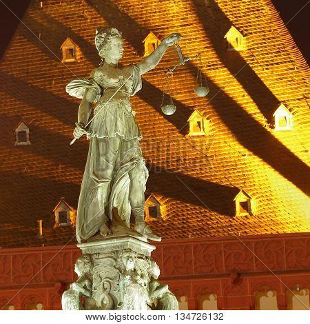 statue of Lady Justice, Frankfurt am Main city night photo