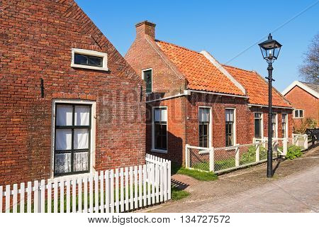 Street in the open-air museum of Enkhuizen on a sunny  spring day, The Netherlands