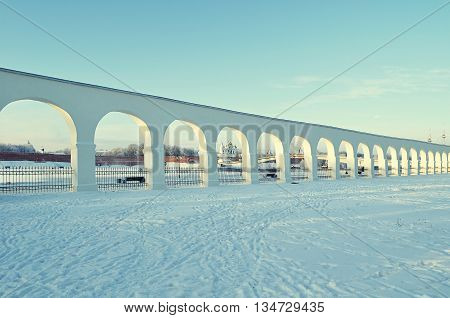 Winter architecture landscape- architecture landmarks ancient architecture arcade of Yaroslav courtyard and Kremlin fortress in the in Veliky Novgorod Russia winter architecture view vintage tones