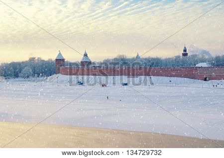 Architecture landscape - winter view of Novgorod architecture - architecture birds eye view of Kremlin towers near the Volkhov river in cold mist in Veliky Novgorod Russia architecture landmark