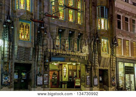 AMSTERDAM, NETHERLANDS - MAY 5, 2013: It's a night view of a building Theater Tuschinski presenting an eclectic mix of different styles.