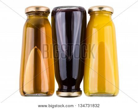 Lying Inverted Bottles With Fruit Juices Isolated On White