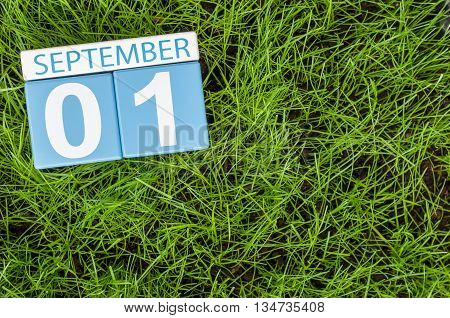 September 1st. Image of september 1 color calendar on green lrass lawn background. Autumn day. Empty space for text. Back to school time.