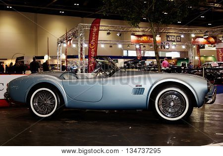 LONDON - JANUARY 10: A vintage Cobra sports car is placed on public display at the inaugural London Classic Car Show event held at the Excel arena on January 10, 2015 in London