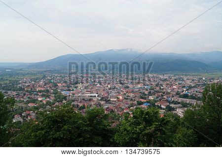 View of the city of Hust which is located near the mountains from the hill of the old castle ruins