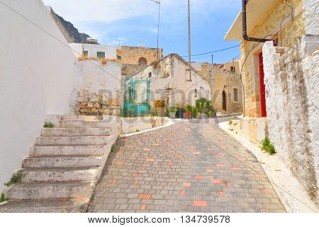 The narrow street with old houses in the historic part of Piskopiano Crete Greece.