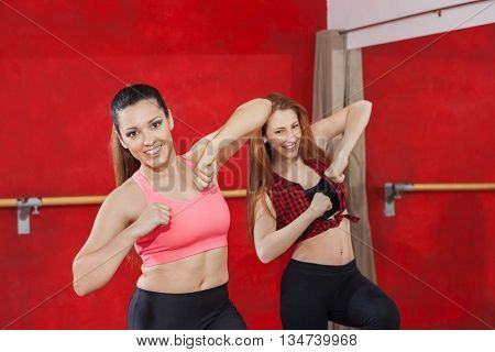 Attractive Women Dancing Together In Zumba Class