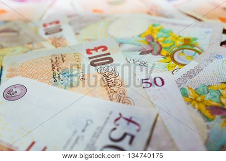 Selective focus of pound money business finance making money concept.