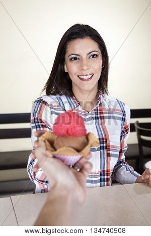 Smiling Woman Receiving Ice Cream From Waiter In Parlor