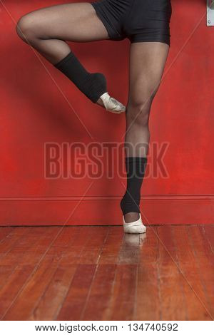 Ballet Dancer Standing On One Leg In Studio