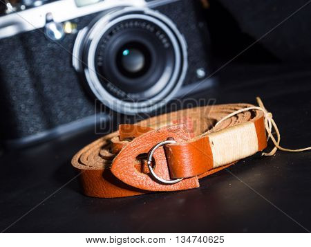 Genuine Cow Leather Low Key Image Background With Film Camera