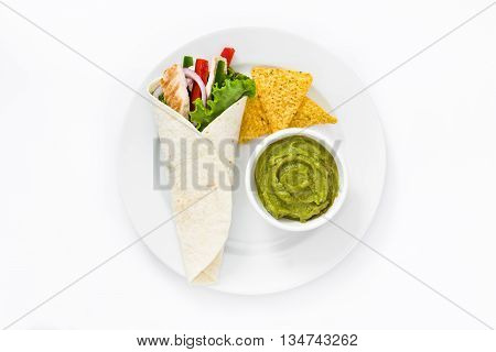 Mexican chicken fajitas with peppers lettuce and onion on a plate isolated on white background