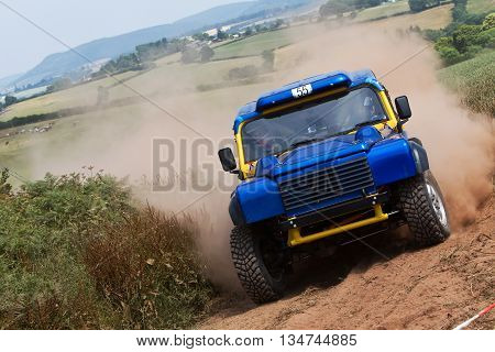 WULSTAN, UK - JULY 21: An unnamed driver turns in to take the final field gate before heading toward the finish line during the AWDC UK Brit Part Comp Safari competition on July 21, 2013 in Wulstan.