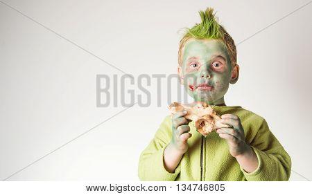 little boy dressed as a zombie on halloween