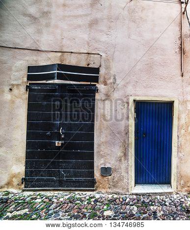 two rustic doors in Alghero in Italy