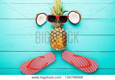 Summer fruits and accessories on blue wooden background. Top view and selective focus