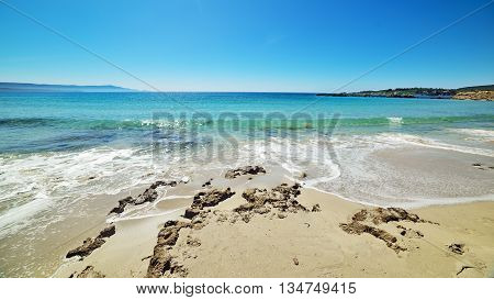 turquoise water in Le Bombarde beach Sardinia