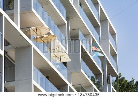 Parasols on the balcony of a contemporary apartment block in Rotterdam in the Netherlands