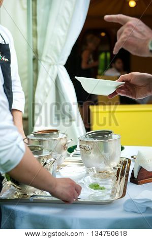 waiters serve ice cream during a party