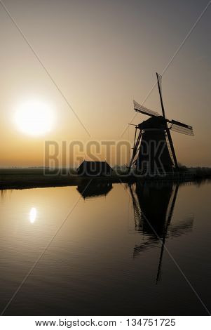 Achtkante mill near Groot-Ammers in the Dutch region Alblasserwaard in backlight