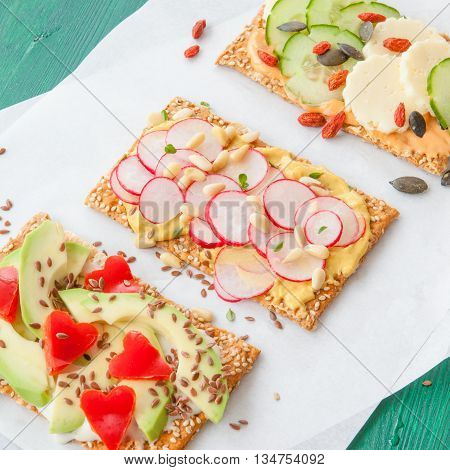 Crispbread with various bread spreads and fresh veggies