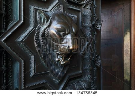 LYON, FRANCE - MAY 24, 2015: This is lion's head on the front door of the Basilica of Notre Dame de Fourviere.